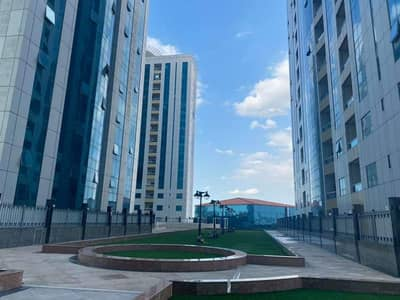 2 Bedroom Flat for Rent in Al Bustan, Ajman - Move-in Ready! Available for Rent 2 BHK Apartment in Orient Tower with Parking