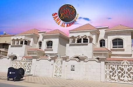 5 Bedroom Villa for Sale in Al Mowaihat, Ajman - Bright new villa with a stone facade and modern design for sale in Ajman