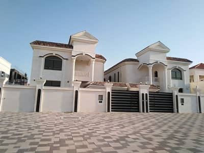 5 Bedroom Villa for Sale in Al Mowaihat, Ajman - Owns a beautiful luster and modern finishing. Central air conditioning. Syrian stone facade