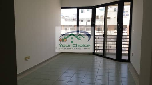 1 Bedroom Flat for Rent in Tourist Club Area (TCA), Abu Dhabi - No Security Deposit |Bright & Spacious 1 Bedroom with Wardrobes & balcony  for 40