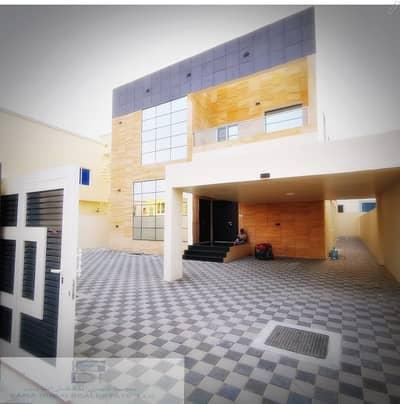 6 Bedroom Villa for Sale in Al Rawda, Ajman - Bright new villa with a stone facade and modern design for sale in Ajman