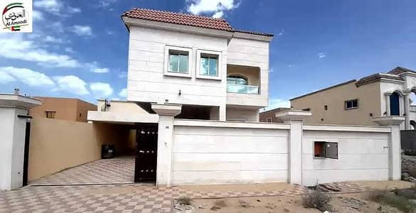 6 Bedroom Villa for Sale in Al Rawda, Ajman - An elegant new villa close to a mosque with a large building area and a super deluxe finishing and an excellent location close to all services