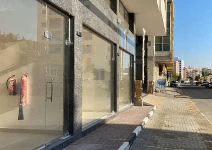 محل جديد ببرج وسط عجمان- بدون عمولة - شهر مجاني