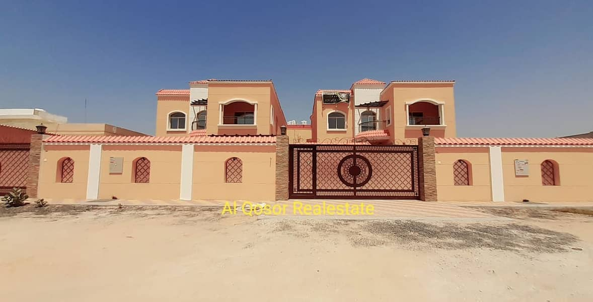 Villa for sale in Ajman, Rawda, super deluxe finishing with the possibility of bank financing