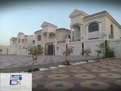Villa unique design and wonderful central air conditioning near Sheikh Ammar Street in the most prestigious areas (Ajman) for freehold for all nationalities