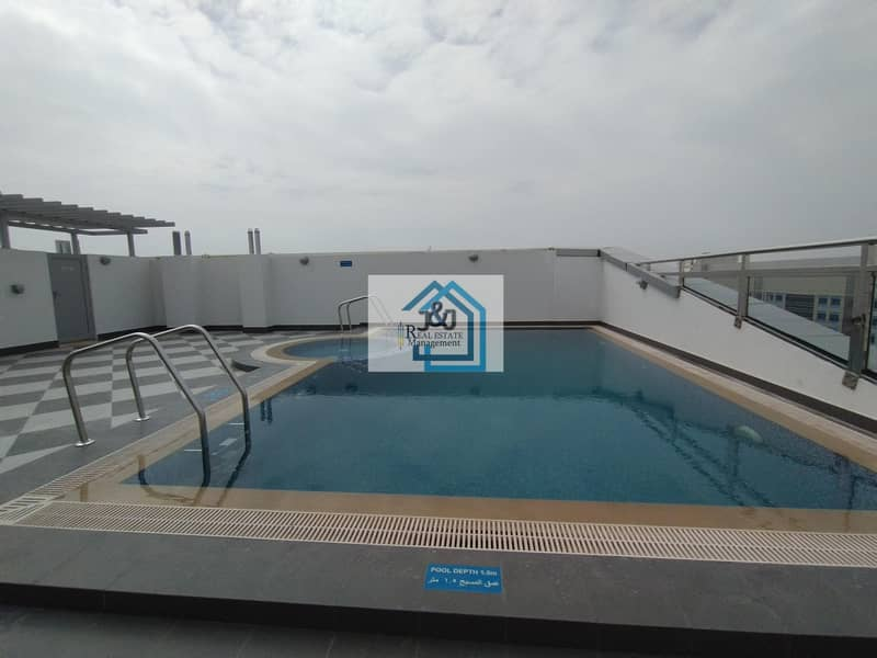 Stylish Brand New 2 Bedroom Apartment with laundry room and Parking Gym & Pool Al Nahyan Camp