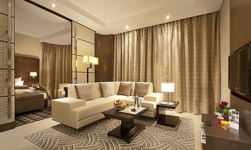 1 Bedroom Flat for Rent in Tourist Club Area (TCA), Abu Dhabi - Living Area