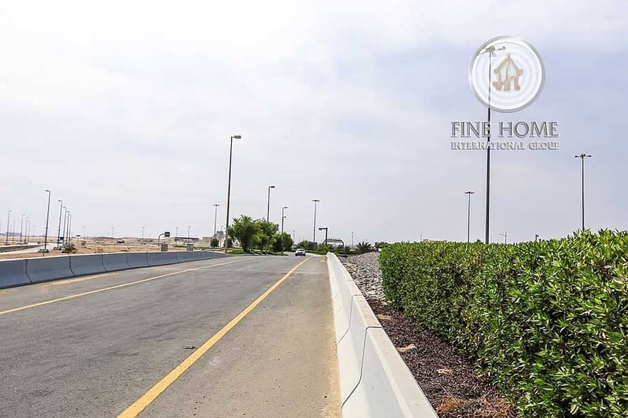 12 Commercial land on Main Road in Zayed City