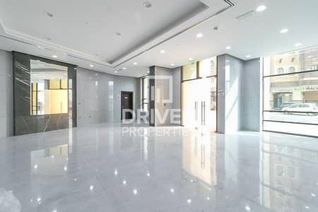 Shop for Rent in Bur Dubai, Dubai - Road Exposure