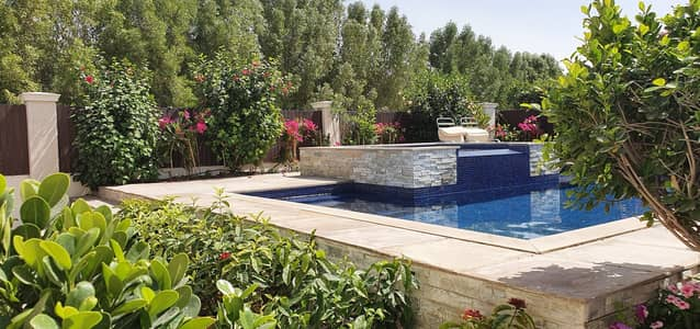 4 Bedroom Villa for Sale in Green Community, Dubai - Pool & Garden