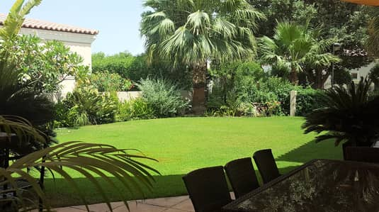 4 Bedroom Villa for Sale in Green Community, Dubai - Matured Manicured garden
