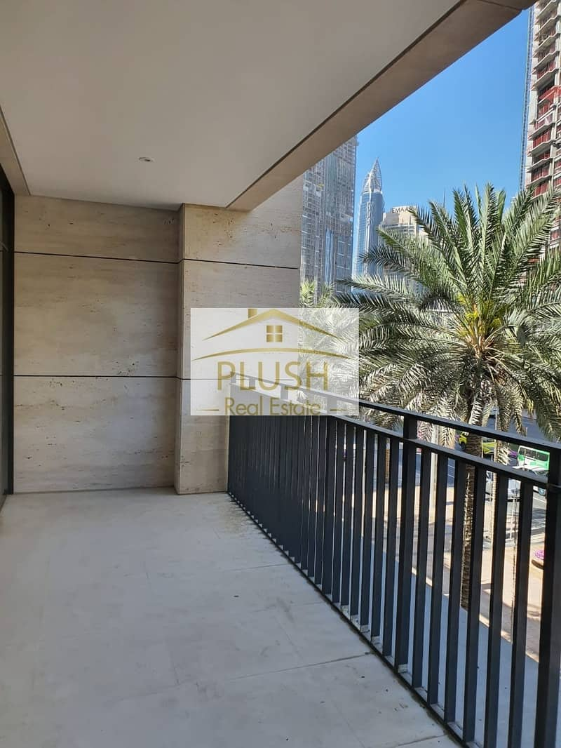 2 BURJ KHALIFA VIEW-NEGOTIABLE PRICE- SEMI FURNISHED- NEW APARTMENT-EMAAR