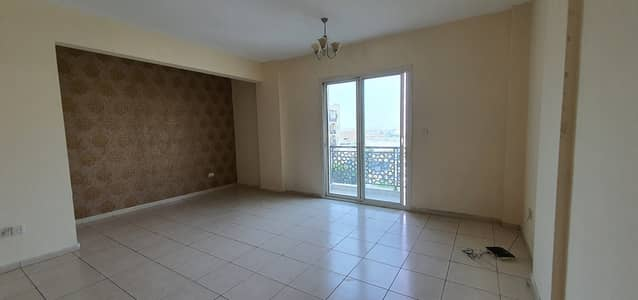 Studio for Rent in International City, Dubai - LARGE STUDIO EMIRATES CLUSTER AVAILABLE FOR RENT WITH BALCONY  IN INTERNATIONAL CITY ONLY 19,000 YEARLY
