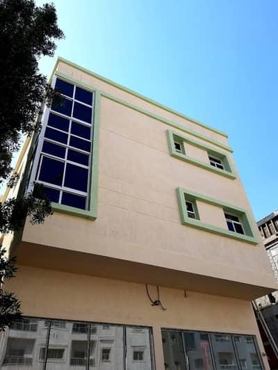 مبنی تجاري  للبيع في الروضة، عجمان - building