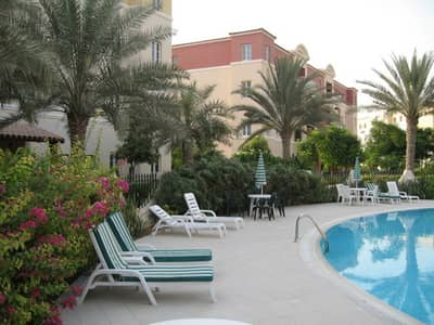 1 Bedroom Flat for Rent in Green Community, Dubai - Community swimming pool