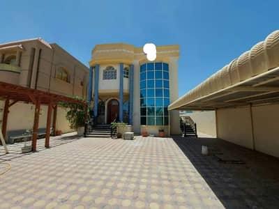 5 Bedroom Villa for Sale in Al Mowaihat, Ajman - The Villa with personal decorations in Ajmn