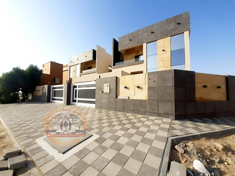 Villa for sale in Ajman, Al Mowaihat, modern design, super deluxe finishing with the possibility of bank financing