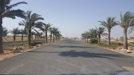 land Commercial for sale in global city ajman