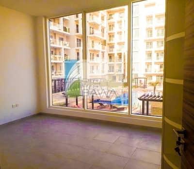 Studio for Rent in Dubailand, Dubai - Beautiful Pool View Studio apartment with kitchen appliances  for rent in Majan Near to Al Barari
