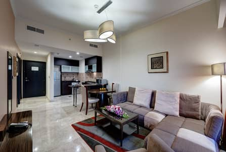 1 Bedroom Hotel Apartment for Rent in Dubai Production City (IMPZ), Dubai - Living room