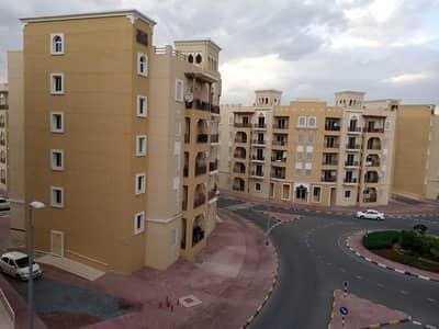 شقة 1 غرفة نوم للايجار في المدينة العالمية، دبي - شقة في الحي الإماراتي المدينة العالمية 1 غرف 27000 درهم - 4619732