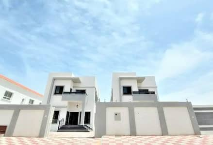 5 Bedroom Villa for Sale in Al Mowaihat, Ajman - Villa for sale in the best areas of Ajman, where calm and full services along with many features, it is close to Sheikh Ammar Street, Mohammed bin Zayed Street and Ajman Academy and all educational services