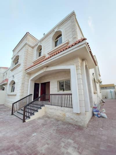 5 Bedroom Villa for Rent in Al Mowaihat, Ajman - Stone front villa for rent in Ajman close to the neighbor street