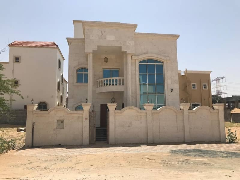Villa for sale in Ajman in Jasmine area with electricity and water