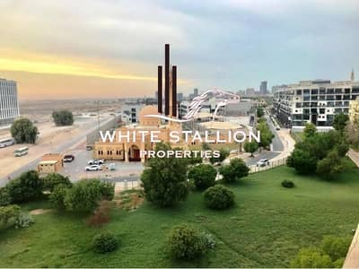 1 Bedroom Apartment for Rent in Motor City, Dubai - COMMUNITY VIEW   BALCONY   LARGE 1 BHK   KITCHEN APPLIANCES IN DICKENS CIRCUS 1