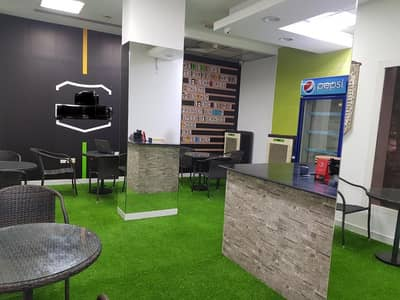 Shop for Rent in International City, Dubai - CHEAPEST RUNNING FAST FOOD RESTAURANT IN R-2