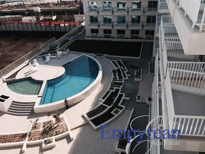 Studio for Rent in Jumeirah Village Circle (JVC), Dubai - POOL VIEW|LARGE FURNISHED STUDIO| WITH BALCONY KENSINGTON MANOR