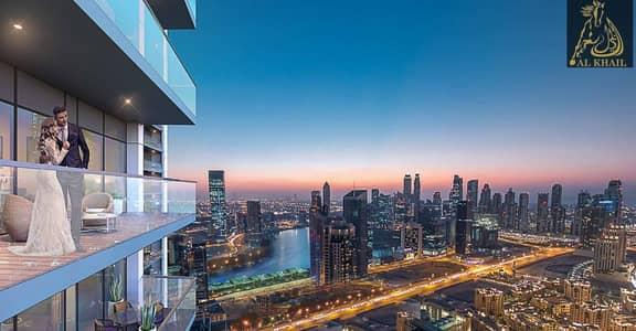 فلیٹ 1 غرفة نوم للبيع في الخليج التجاري، دبي - Opulent 1BR Apartment in Business Bay 10% Expected ROI Canal View