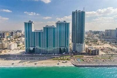 2 Bedroom Flat for Sale in Corniche Ajman, Ajman - Urgent 2BHK for Sale| City & Sea View | Free Furniture
