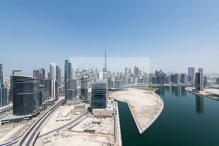 2 Bedroom Flat for Rent in Business Bay, Dubai - Canal/Burj Views | Two bedrooms + Maid | Churchill