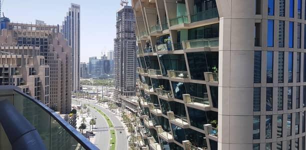 فلیٹ 2 غرفة نوم للايجار في وسط مدينة دبي، دبي - Sea View & Blvd View. Best of Both View.