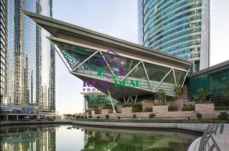 مکتب  للايجار في أبراج بحيرات الجميرا، دبي - Spacious shell and core Office / Almas Tower