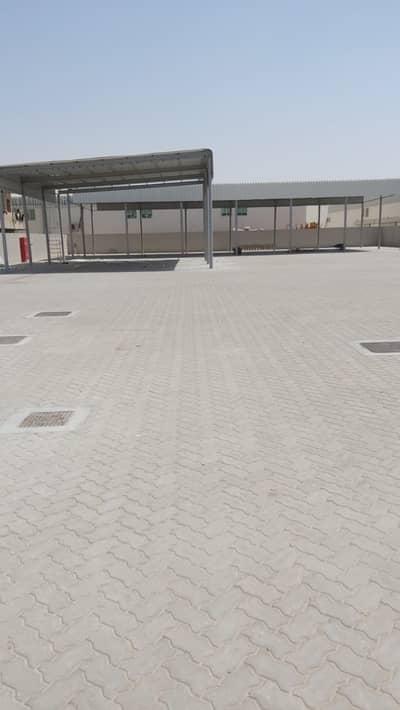 ارض صناعية  للايجار في مدينة الإمارات الصناعية، الشارقة - للايجار حوطه  في الصجة الحنو بلوك 4 مقابل سكراب