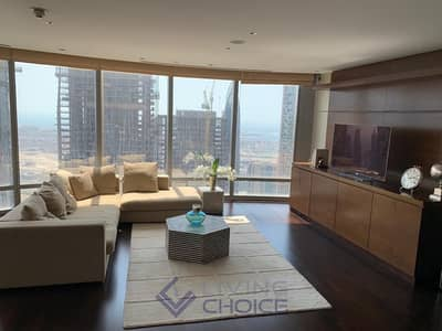 2 Bedroom Flat for Rent in Downtown Dubai, Dubai - Fully furnished | Partial Lake & Sheikh Zayed View