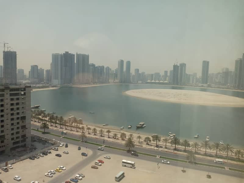 Sea View Luxury 2BR with Balcony Gym Pool Parking at Al Khan Corniche