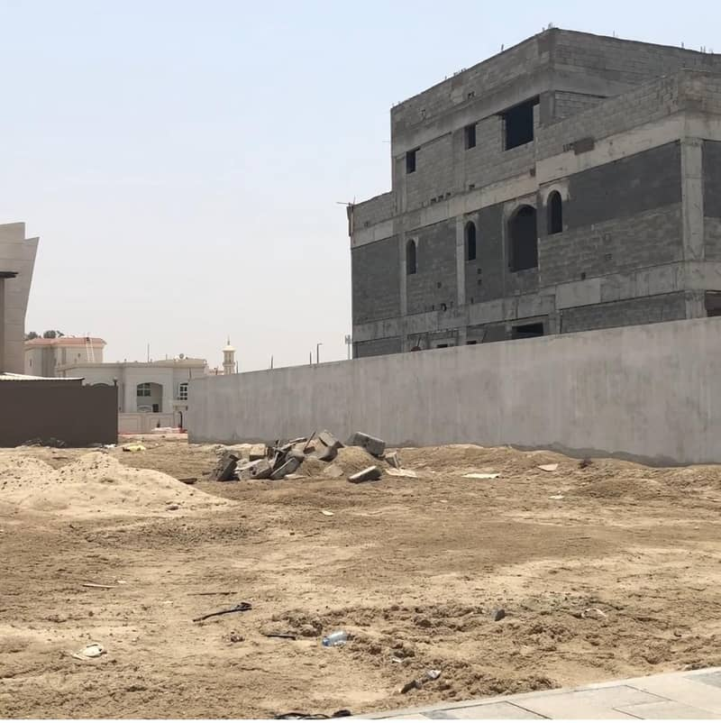 Residential land for sale, Khalifa City, a corner and public street