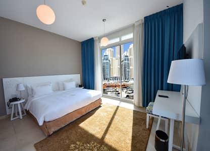 شقة فندقية  للايجار في دبي مارينا، دبي - شقة فندقية في جنة بلايس دبي مارينا دبي مارينا 60000 درهم - 3467258