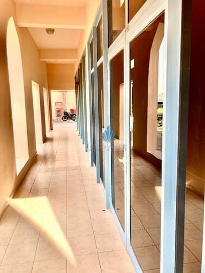 Shop for Rent in International City, Dubai - Corridor