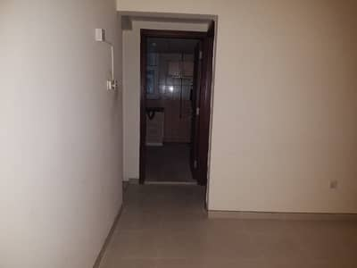 1 Bedroom Flat for Rent in Bu Tina, Sharjah - BIG 1BHK WITH CLOSE HALL AND CENTRAL AC