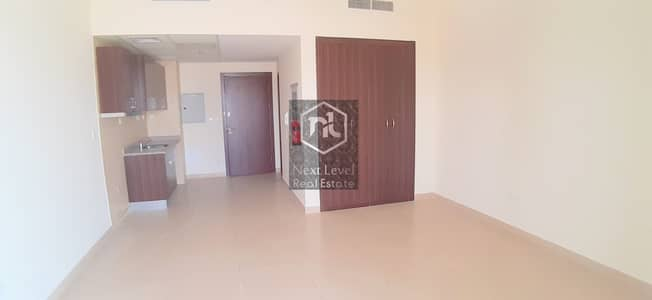 Studio for Rent in Dubai Sports City, Dubai - CHILLER FREE STUDIO WITH BALCONY AND PARKING IN STADIUM POINT-SPORTS CITY