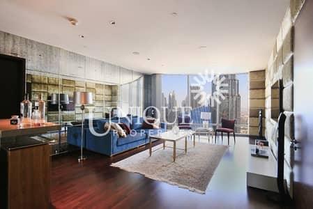 فلیٹ 2 غرفة نوم للايجار في وسط مدينة دبي، دبي - Furnished   Partial Sea View   High Floor