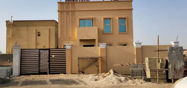 Directly on Sheikh Mohammed bin Zayed Street, the best villa in Ajman, fully finished and without notes with the possibility of freehold ownership in Ajman for all nationalities Entrance and exit very easy for Dubai and Sharjah