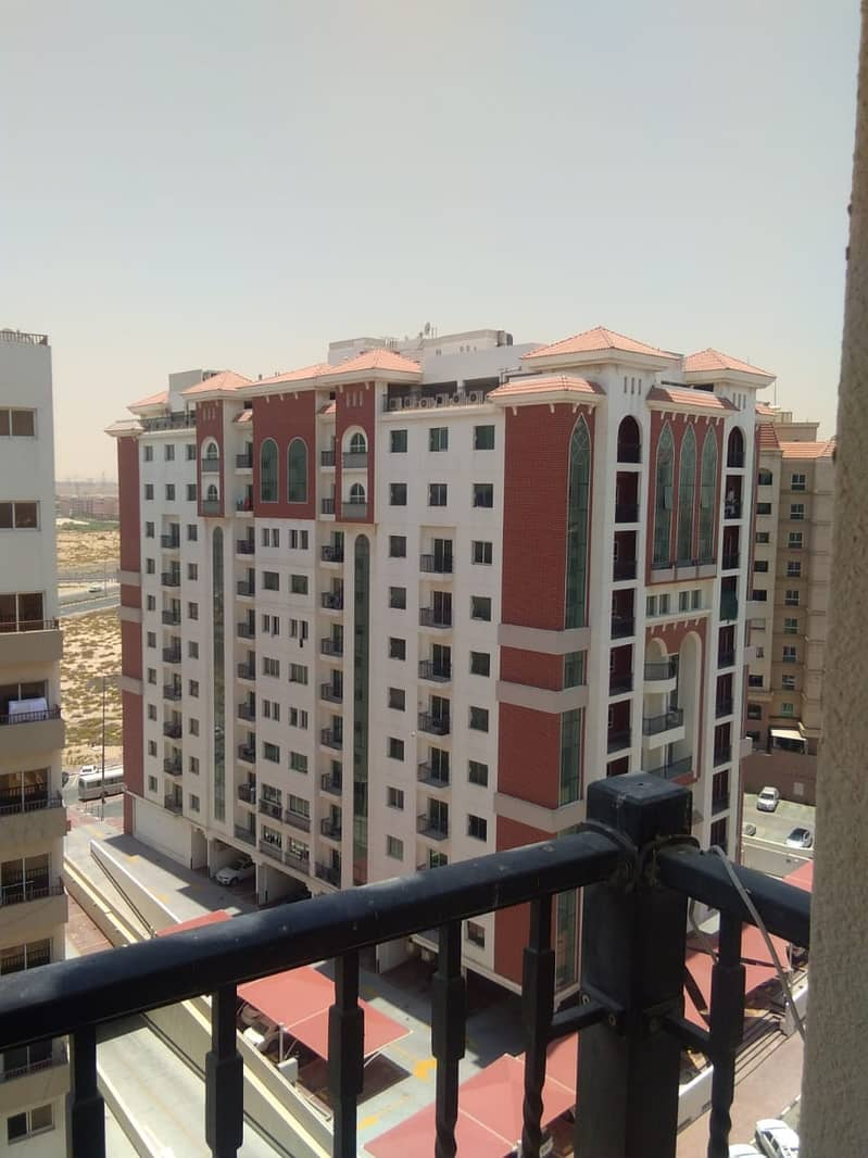 CBD Studio with balcony pool gym parking kitchen equipped