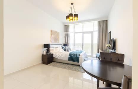 استوديو  للايجار في قرية جميرا الدائرية، دبي - Furnished and Brand New Apt with Amazing View