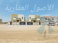 Villa for sale in Ajman, Al Mowaihat area, on a direct street, near the corner of two excellent design streets, with the possibility of bank financing