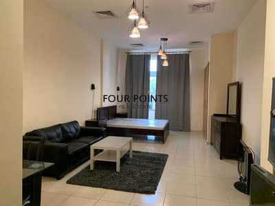 Studio for Rent in Jumeirah Village Circle (JVC), Dubai - Furnished & Spacious Studio in Emirates Garden